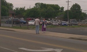 Bro. Greg chased the lady across the street to give her a Bible which she gladly received.